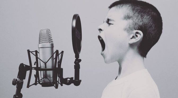 a child screaming into a microphone